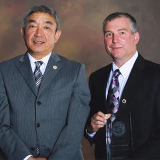 Honda Executive Vice President and COO Takuji Yamada (left) and Crown Packaging President Michael K. Palmer (right)
